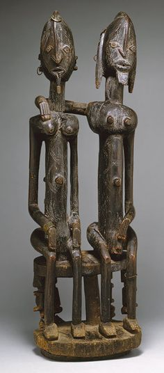 Dogon seated couple, Mali, 16th-19th century (wood, metal)