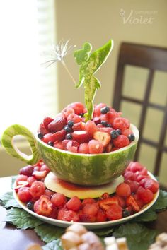 what a fun way to serve fruit at a children's tea party! :) (Or a big kid's tea party!Tinkerbelle Watermelon and fruit salad! great idea for a party. Love the teacup shaped watermelon. Omit Tinkerbelle for a cute idea for a tea party. Watermelon Benefits, Watermelon Fruit, Watermelon Centerpiece, Watermelon Carving Easy, Watermelon Appetizer, Carved Watermelon, Watermelon Ideas, Fairy Tea Parties, Tea Party