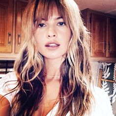 Love love these bangs and hair color. Behati Prinsloo's Wispy Bangs: Fueling Our Fringe Obsession – Vogue