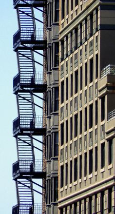 wanderingnewyork:  Windows and a fire escape on the Upper West Side.