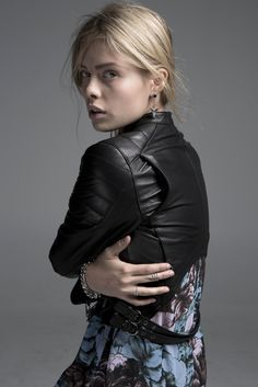 Capulet's quilted leather jacket and Clover Canyon's floral dress. Bracelets and rings by Luv Aj; earrings by Anita K. [Photo by Baldomero Fernandez]