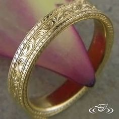 Antique Style 18k Yellow Gold 4mm Band with three sections of Engraving, Center section Scroll and Leaf pattern, two outside rails Half Wheat pattern with four rails of Milgrain separating the sections.