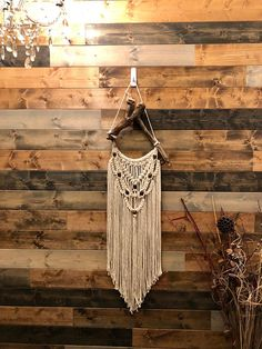 Macrame wall hanging made with soft 100% cotton twisted string. This wall hanging is truly one of a kind-look at that unique driftwood! I love how much character it has. The total length of this piece including the hanger is 41 inches long. The width is 10.5 inches.