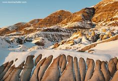 Photo by Kevin Schafer @schaferpho - Drumheller badlands sediments of Cretaceous age in area famous for its dinosaur fossils Alberta Canada. I raced for 5 hours to get here at last light and had four minutes before the sun went behind the ridge. Talk about getting creative fast... #dinosaurs #drumheller #natgeo #natgeocreative #badlands #Alberta by thephotosociety