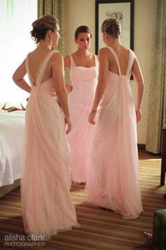 .Very pretty! Flowy light pink long bridesmaids dress. Great for a formal wedding. Would even work for a beach wedding if they were shorter!