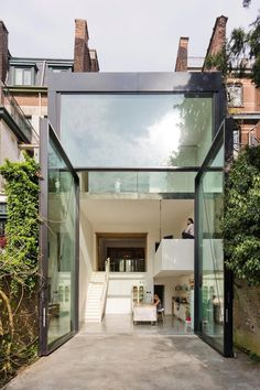 Sculp[IT] design a Town House in Antwerp with the worlds largest pivoting window - CAANdesign | Architecture and home design blog
