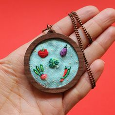 Hand embroidered tiny veggies wooden necklace, would be a great gift for your vegan loved ones or for you..   Details:  -A tomato, an eggplant,