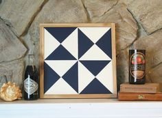 *In stock and ready to ship. We can ship this barn quilt out the next business day after ordering. We created these simple 2-color barn quilts to be hung inside your home. Framed in cedar this barn quilt measures 13-1/4 x 13-1/4. Painted in dark blue and ivory and finished with a satin polyurethane. Hardware attached and ready to hang in your home. *We can customize these barn quilts with different colors and patterns. *Please note that this barn quilt is not suitable for hanging outside*