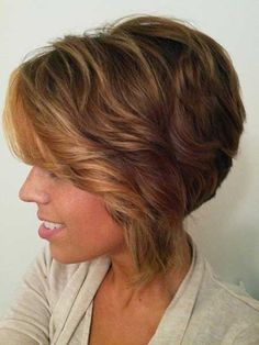"""Wavy Asymmetric Bob Hairstyle  1. Apply heat protectant.   2. Using a 1"""" curling iron, take large vertical sections and curl hair away from the face.  3. Continue working around the head.  4. Allow curls to cool.  5. Break up curls with fingers.    #stackedbob  http://www.latest-hairstyles.com/trends/long-faces.html"""