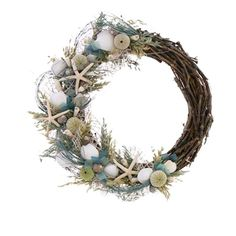Coastal-inspired wreath with seashell and dried grass accents.  Product: WreathConstruction Material: Dried gras...