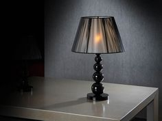 Big tablelamp made with acrylic material, methacrylate type, black. Tightened thread shade in black or silver colour, lined inside.