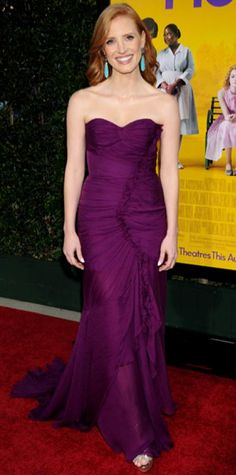 Look of the Day › August 10, 2011 WHAT SHE WORE Chastain arrived at the premiere of The Help in a ruched Oscar de la Renta gown that she styled with agate Sutra danglers and metallic Jimmy Choo heels.