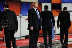 Republican presidential candidate Donald Trump remains standing at the front of the stage as his rivals head to their podiums at the start of a debate in Detroit, Mich., March 3, 2016. (Photo by Jim Young/Reuters)
