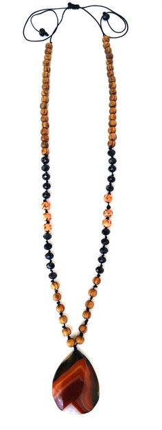 Southfields - Unique and one of a kind, sparkle bright in this handmade Lydia of London necklace. Made with wood beads, black Swarovski crystal and precious gem stone pendant. Adjustable in size so can be worn long or shorter around the neck. #mala