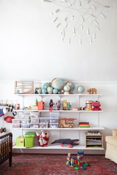 Impressive use of space, love the children's toy wall.  A CUP OF JO: San Francisco apartment tour (500-square-feet!)