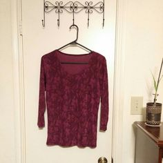 Beautiful rose print blouse Burgandy blouse decorated with gorgeously detailed roses. Material is smooth, is very stretchy, and has a wonderful drape.  Will fit sizes S to M. Tops Blouses