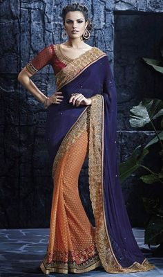Incite your admirers to bask in your glory dolled up in this orange and blue color net chiffon half n half sari. The ethnic lace, resham and stones work with the attire adds a sign of magnificence statement for the look. #onlinechiffonsaris #nethalfnhalfsari #borderworksarees