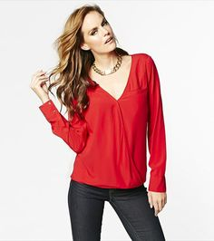 Wrap yourself in this elegant yet sexy wrap front blouse! Pair it with leggings, jeans or tucked into a pencil skirt. #wishlist #dynholiday