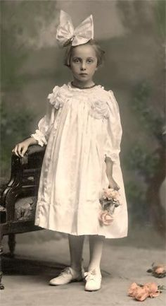 Hand colored Edwardian photo of little girl with flowers