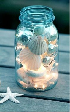Twinkle tights and seashells in a mason jar cozy summer decor. For Maternity Inspiration, Shop here >> www.seraphine.com/us | Summer vibes | Summer inspiration | Sun | blue | sea