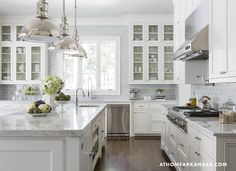 White kitchen with gray marble counters