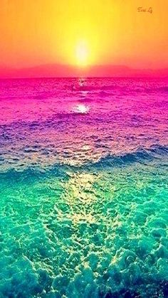 """Sunset with the water's colors altered. It seems like it was simply done using a photo-editing program or something but still it looks neat. It definitely adds a different """"definition"""" to it than it would a regular sunset."""