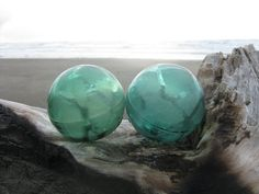 Japanese fishing floats, I've collected for years.  Beautiful beachy colors and worn like regular sea glass.  bbt