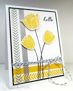 "prietty handmade card from Stamping with a Passion! ... trendy gray and yellow ... great use of washi tape for a two-sided frame ""woven"" in one corner ... luv how the translucent tape changes color at the crossings ... some stamped tulips too ..."