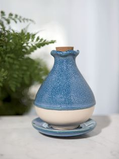 This blue glazed ceramic essential oil diffuser disperses a light scent through the unglazed bottom. Essential Oil Diffuser, Essential Oils, Room Diffuser, Room Freshener, Perfume Atomizer, Garden Gifts, Glazed Ceramic, Garden Supplies, Aromatherapy
