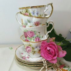 Vintage teaset for four.  Beautiful Vintage bone China mismatched tea set of four teacups and saucers with beautiful floral clusters in shades of pink, blue and yellow and gilded edges all made in England.  They have been put together carefully to compliment each other from odd pieces left over from other sets. Invite your closest friends around for a tea party or use as part of a vintage wedding or celebration.  Individually they are very pretty, but together they are beautiful.  Teacups…