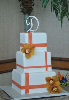 White and Tangerine color wedding cake by The Cake Zone