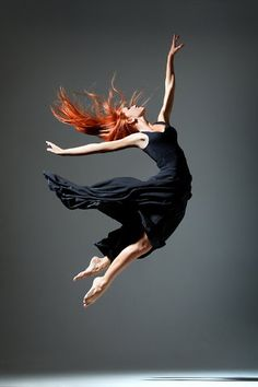 Dance action photograph - an physical expression of how a woman feels inside when her heart is full and her soul is free.