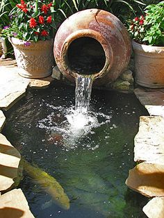 Nice use of a pot fountain and a small pond. Nice use of a pot fountain and a small pond. Ponds For Small Gardens, Small Ponds, Backyard Water Feature, Ponds Backyard, Outdoor Fish Ponds, Koi Pond Design, Garden Water Fountains, Garden Waterfall, Waterfall Fountain
