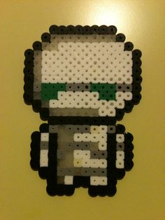 An adorable version of Marvin the Paranoid Android, from Hitchhiker's Guide to the Galaxy. Some pale yellow beads ended up in there… oops. D...