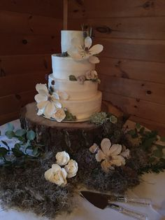 Wedding cake with edible magnolias and succulents. Southern weddings