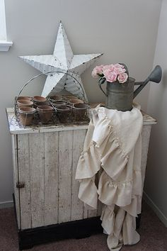 love the chippy cupboard and the tiny clay pots