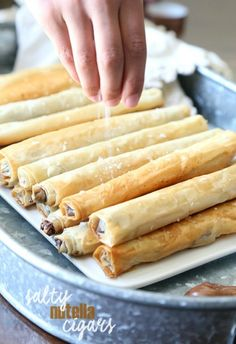 """These Crispy Salty Nutella """"Cigars"""" are SO SO amazing! They're crispy, salty, buttery and filled with creamy Nutella!"""