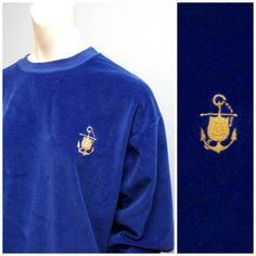 Adorable vintage sweatshirt. Royal blue velour with an embroidered golden anchor over the chest. Size is large. Fits slightly oversized. Brand is Carolina Clothing Co. In excellent condition with no visible holes or stains