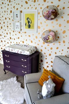 Move over polka dots! How fun is this spotted accent wall in this whimsical nursery?!