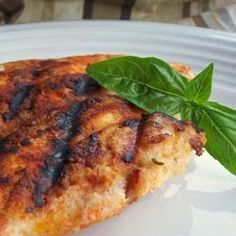 "Spicy Chicken Breasts   ""This is a great skinless, chicken breast recipe that can be served over salad greens or as an entree! If serving over salad greens, cut chicken into strips and top with your favorite salsa or dressing."""