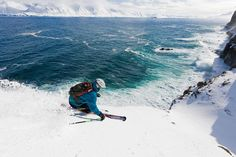 """SKIING ICELAND'S TROLL PENINSULA""""We were so lucky this time,"""" says photographer Fredrik Schenholm of this image of skier Martin Hesse. Just as Hesse, skiing along the edge of a cliff on Iceland's Troll Peninsula, passed him, waves hit the rocks. """"This is what I love so much about adventure photography: Sometimes I just don't know if I will succeed in getting the shot I envision. I like it when nature has its say in my photography."""""""