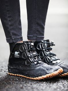 Out N About Glow Weather Boot   Wade through the weather in this good-looking shoe, that's waterproof to boot. Handcrafted with an adjustable bungee lace-up and durable textured soles made from natural rubber.    *By Sorel