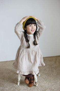 Gauzy oatmeal linen with ruffles/elastic at neck and wrists in white, dropped waist, long length