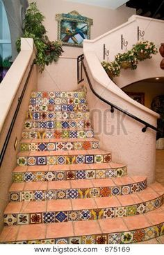 Spanish tile for the stairway to the mirador. Handmade tiles can be colour coordinated and customized re. shape, texture, pattern, etc. by ceramic design studios