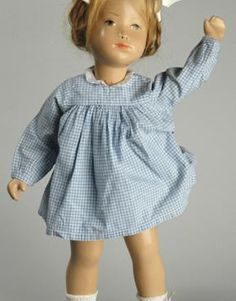 A later Studio doll with 6 piece body construction, human hair wig, original grey and white signature tag on gingham Studio fashion, all handcrafted at the artist's atelier in Zürich, Switzerland, 1960-65, by Sasha Morgenthaler.