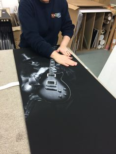 Nicki is working on a signed Slash guitar display today! Everything here at FrameMaker is handmade by our expert framers!