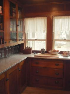 Old farmhouse kitchen. Love the cabinets!