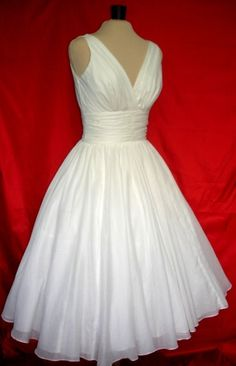 The perfect simple but elegant 50s style dress made by elegance50s, $255.00..