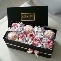 Floral arrangement in gift box
