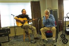Arbour Square resident joins guest entertainer Joe Fromm with his harmonica!